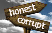 Honest x Corrupt creative sign — Stock Photo