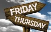 Friday x Thursday on wooden sign — Stock Photo