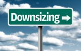 Downsizing creative green sign — Stock Photo