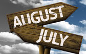 August x July on wooden sign — Stock Photo