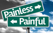 Painless x Painful creative sign — Stock Photo