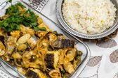 Traditional portuguese codfish with potatoes — Stock Photo