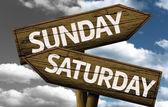 Sunday x Saturday On wooden sign — Stock Photo