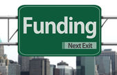 Funding road sign — Stock Photo