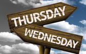 Thursday x Wednesday on wooden sign — Stock Photo