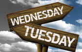 Wednesday x Tuesday On wooden sign — Stock Photo