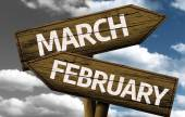 March x February On wooden sign — 图库照片