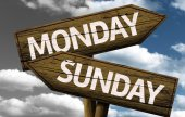 Monday x Sunday on wooden sign — Stock Photo