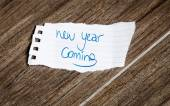 New Year Coming written on the paper — Stock Photo
