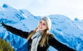 Pretty blonde girl smiling in the Alps. — Stock Photo