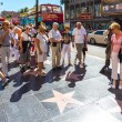 Постер, плакат: Tourists walk on Hollywood Walk of Fame in Los Angeles