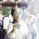 People pray at Senso-ji Temple in Tokyo — Stock Photo #63648731
