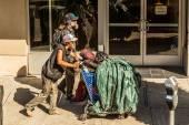 Homeless men walk on the street — Stock Photo