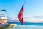 Boat with Swiss Flag on Lucerne, Switzerland. — Stock Photo
