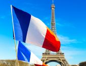 French flag waving in Paris, France — Stock Photo
