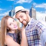 Beautiful couple taking a selfie photo in Melbourne, Australia — Stock Photo #65404929