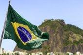 Brazilian waving flag on Rio de Janeiro — Stock Photo