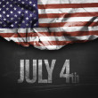 USA flag and July 4th on a blackboard — Stock Photo #66142565
