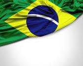 Brazilian waving flag on white background — Stock Photo