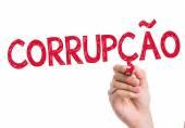 Corruption (Corrupcao in Portuguese) written on the wipe board — Stock Photo