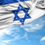 Israeli waving flag on a beautiful day — Zdjęcie stockowe #66981625