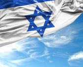 Israeli waving flag on a beautiful day — Stock Photo