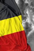 Belgian waving flag on a bad day — Stock Photo