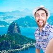 Happy young man taking a selfie photo in Rio de Janeiro, Brazil — Stock Photo #67151775