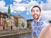 Happy young man taking a selfie photo in Copenhagen, Denmark — Stock Photo