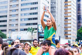 SAO PAULO, BRAZIL - CIRCA MARCH 2015: Protesters marching on Paulista Avenue holding signs with messages against the corruption of Brazilian government in Sao Paulo, Brazil. — ストック写真