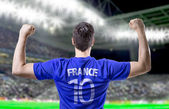 French soccer player celebrating in the stadium — Stock Photo