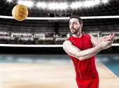 Volleyball player on red uniform on volleyball court — Stock Photo