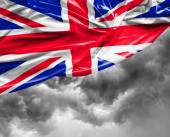 UK waving flag on a bad day — Stock Photo