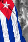 Cuban waving flag on a bad day — Stock Photo