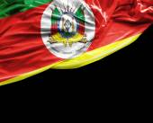 Rio Grande do Sul, Brazil waving flag on black background — Stock Photo