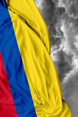 Colombian waving flag on a bad day — Stock Photo