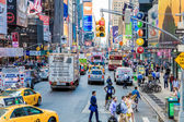 Pedestrians and Vehicles move along Broadway in Times Square in New York City. — Stock Photo