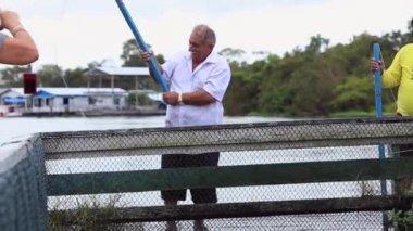 Old man fishing in Manaus — Stock Video