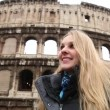 Happy blonde tourist at the Colosseum in Rome — Stock Video #74171021