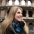 Happy blonde tourist at the Colosseum in Rome — Stock Video #74171039
