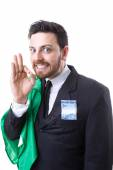 Businessman hiding Brazilian money and the flag of Brazil — Stock Photo