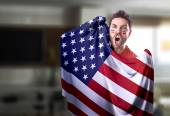 Fan holding the flag of USA at home — 图库照片