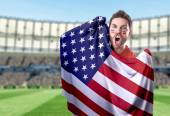 Fan holding the flag of USA in the stadium — Stock Photo