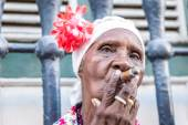 Portrait of african woman smoking cigar — Stock Photo