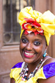 Portrait of african cuban woman looking at camera and smiling — Stock Photo