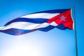 The flag of Cuba waving in the wind against a blue sky — Stock Photo