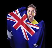 Fan holding the flag of Australia on black background — Stock Photo