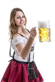 Young blonde woman in traditional bavarian costume on white background — Stock Photo
