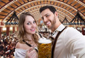 Couple in traditional bavarian costume in Germany — Stock Photo