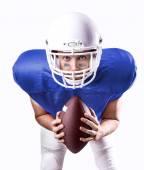 Football Player on blue uniform on white background — Stock Photo